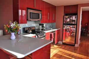 Do not be afraid to design a red and black kitchen. It can look as phenomenal as this one. Click on the photo for other pictures and great decorating ideas.