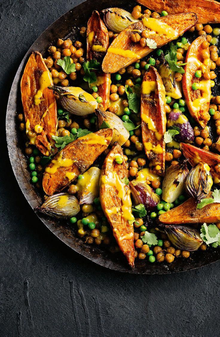 Photo of Spicy sweet potato and chickpea bake with lime tahini dressing