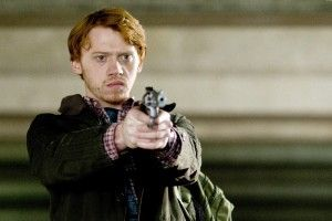 Rupert Grint (Tony) determinedly pointing gun in the car park [1444 Photo.  Nick Wall]