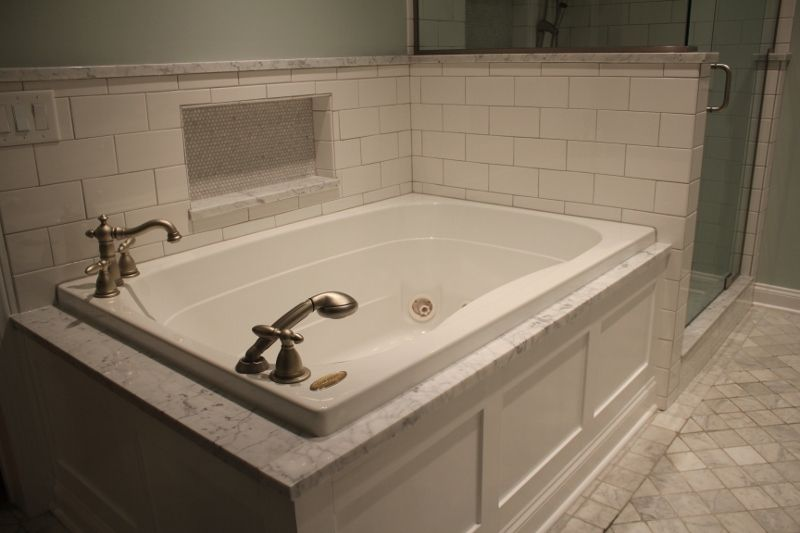 Bathtub With White Paneled Decorative Tub Apron Bathtub