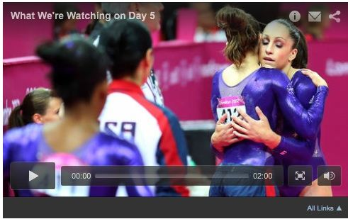 206a:  The image shows a moment of emotion between US gymnasts, reflecting athletes from the same country as the newspaper.  It focuses on US and media favorite, Jordyn Wieber.  Everyone else in the photo is blurred or facing the other direction, showing media and public favoritism towards her as a hopeful for gold.