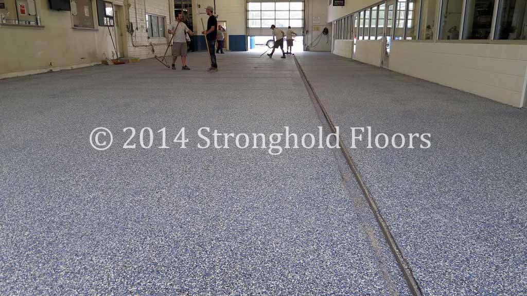 Custom Car Dealership Epoxy floor coating. Epoxy garage