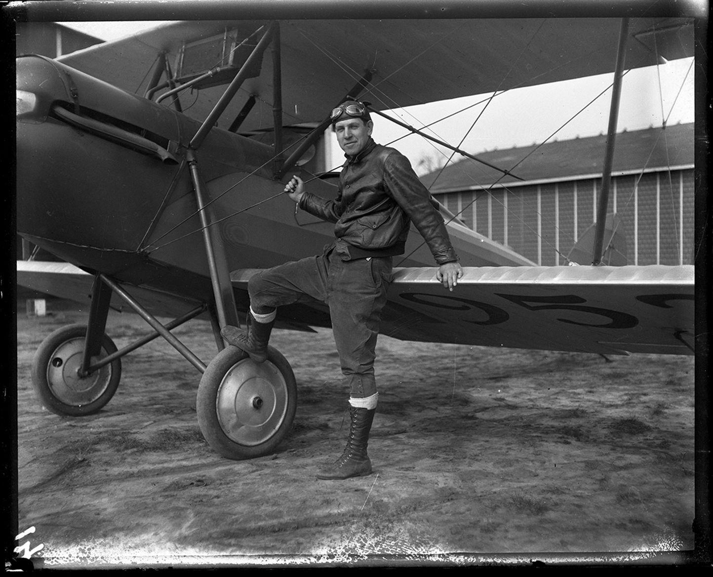 Gelder Lockwood and biplane at Southwest Airport, circa
