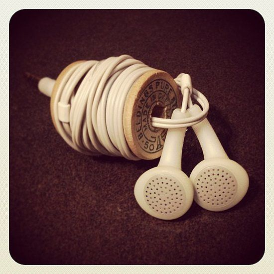 Make Your Own Earphone Holder: Tangled earphones, be gone!  One brilliant idea: tie cords around a wooden spool.  Source: Instagram user sistervalentine