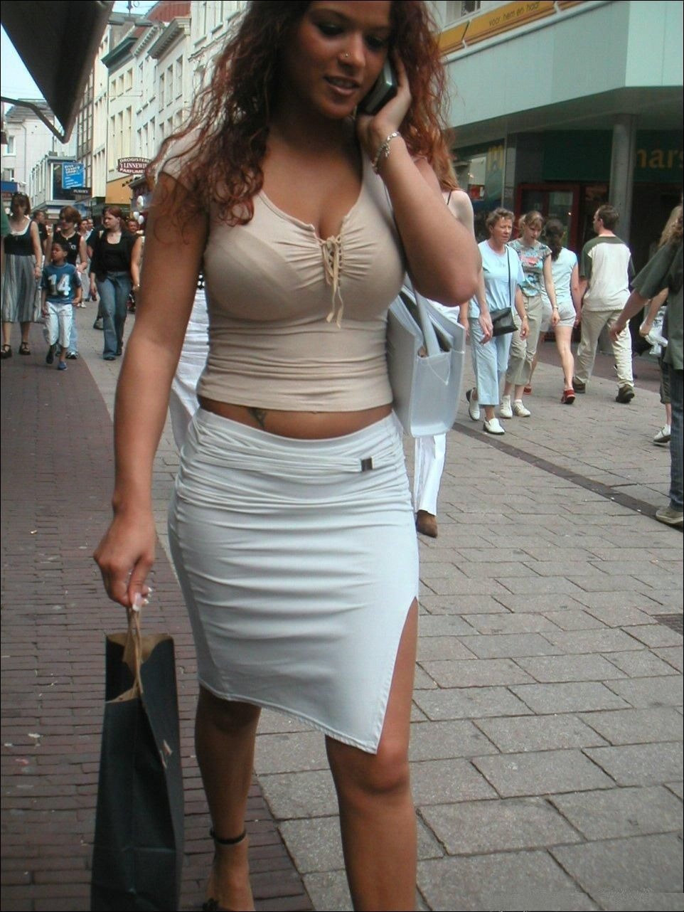 sexy woman in tight skirt with huge breasts