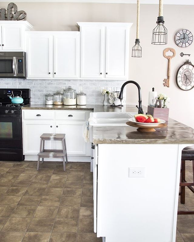 Give an old kitchen new life. @blesserhouse used our ...
