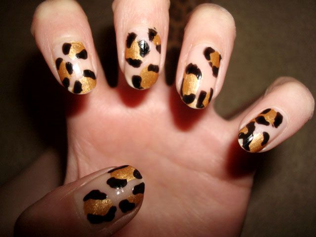 "Must be the absolutely easiest animal print! Here we got more then less the ""dot   basic again"" Start with 3 brown/gold dots. On the side of it, you make more (square ) dots (drag the dot one millimeter to the side ) on the side´s of the other ones (on the corners)   in black 2 - 3 on each one,  finish with a base  coat. For more glam look use a shiny/light glitter brown/gold nail polish!"