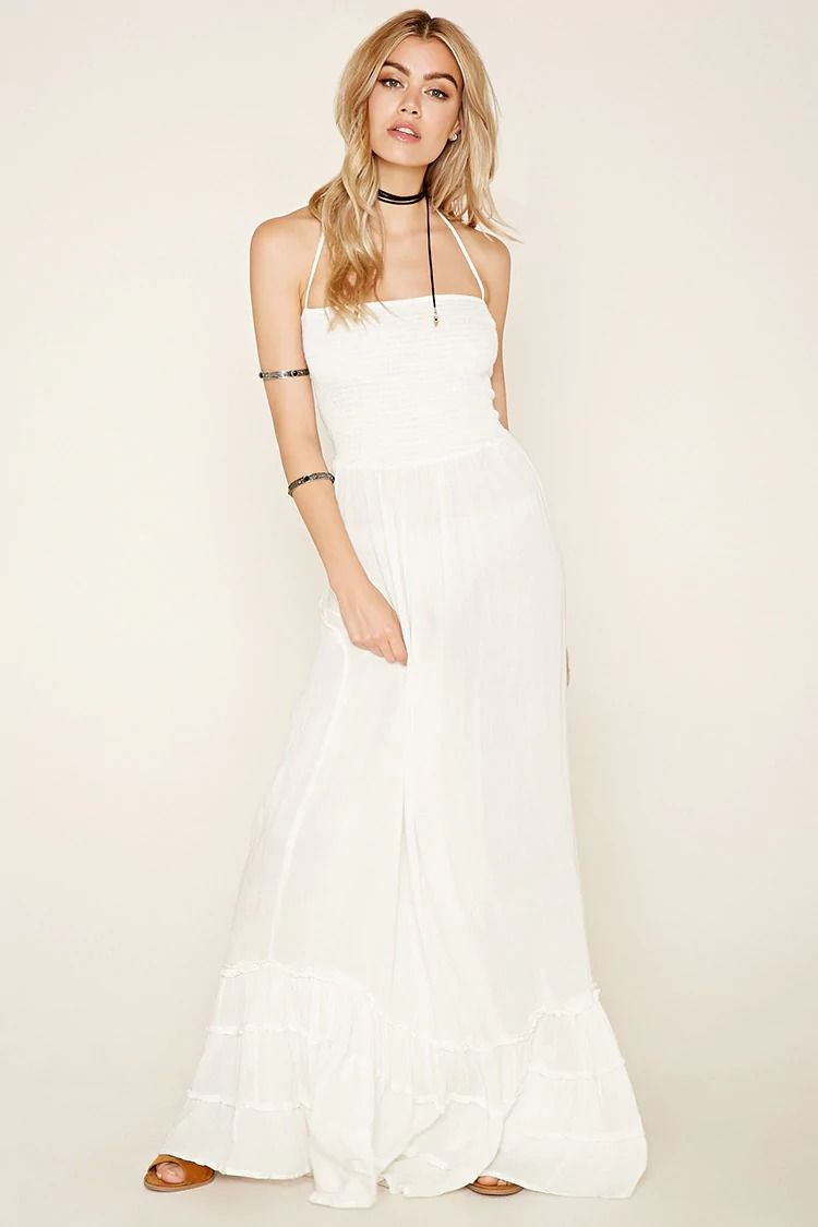 A woven maxi dress from boho me featuring a layered hem a smocked