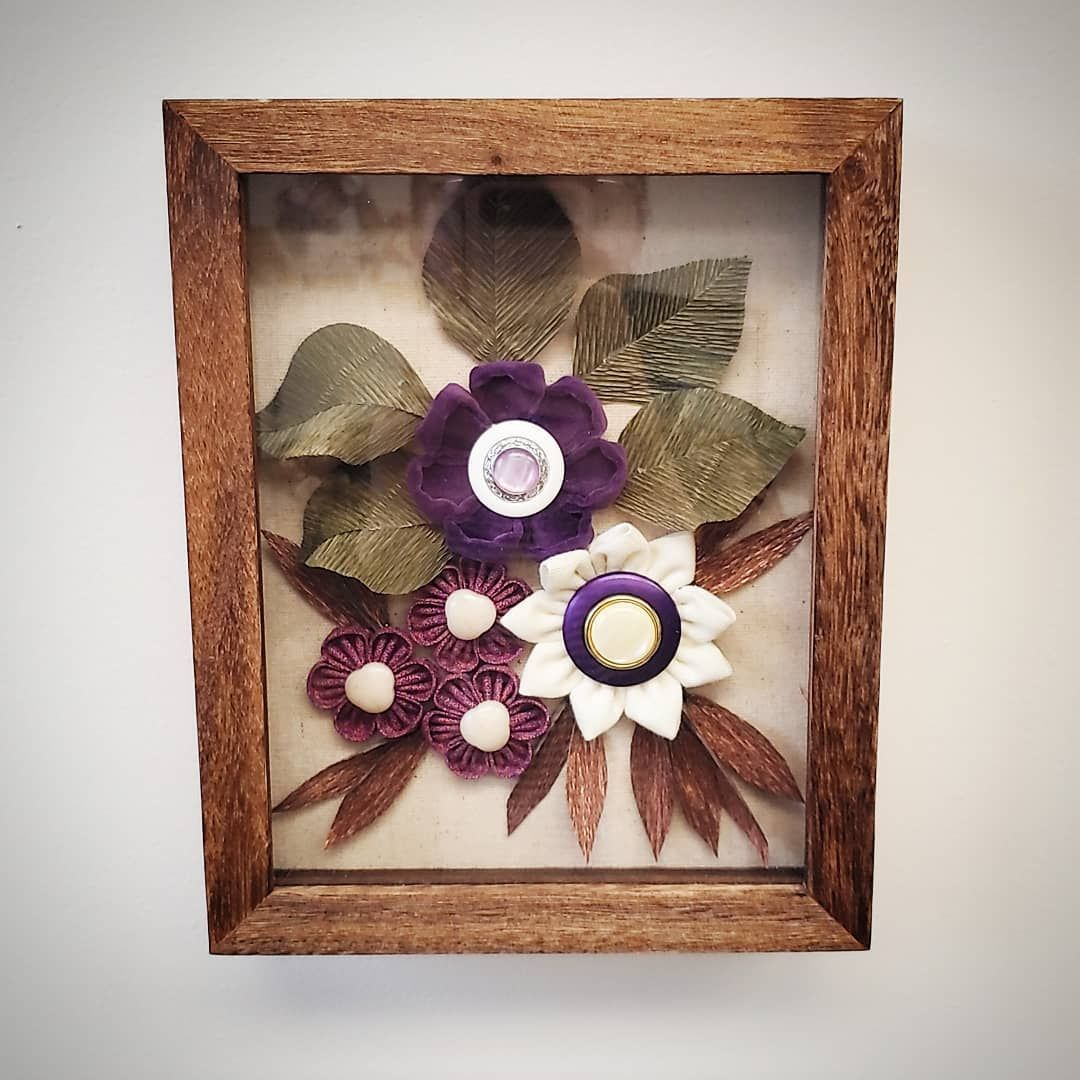 I have had this shadow box unfinished in my studio for about a month and finally figured out how to finish it this past weekend. This vintage purple velvet was tricky to work with but I think it turned out in the end, especially with the over-sized vintage earring centers! . . . #theblossomfactory #nolablossomfactory #nolahandmade #nolacrafter #shadowboxart #fabricflowers #crepepaper #shadowbox #handmadeflowers #handmadedecor #vintagefabric #vintagebuttons #vintagejewelry #repurposedvintage #rep