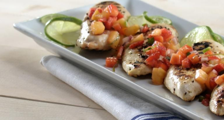 Grilled Chicken with Strawberry Chili Salsa on a white plate