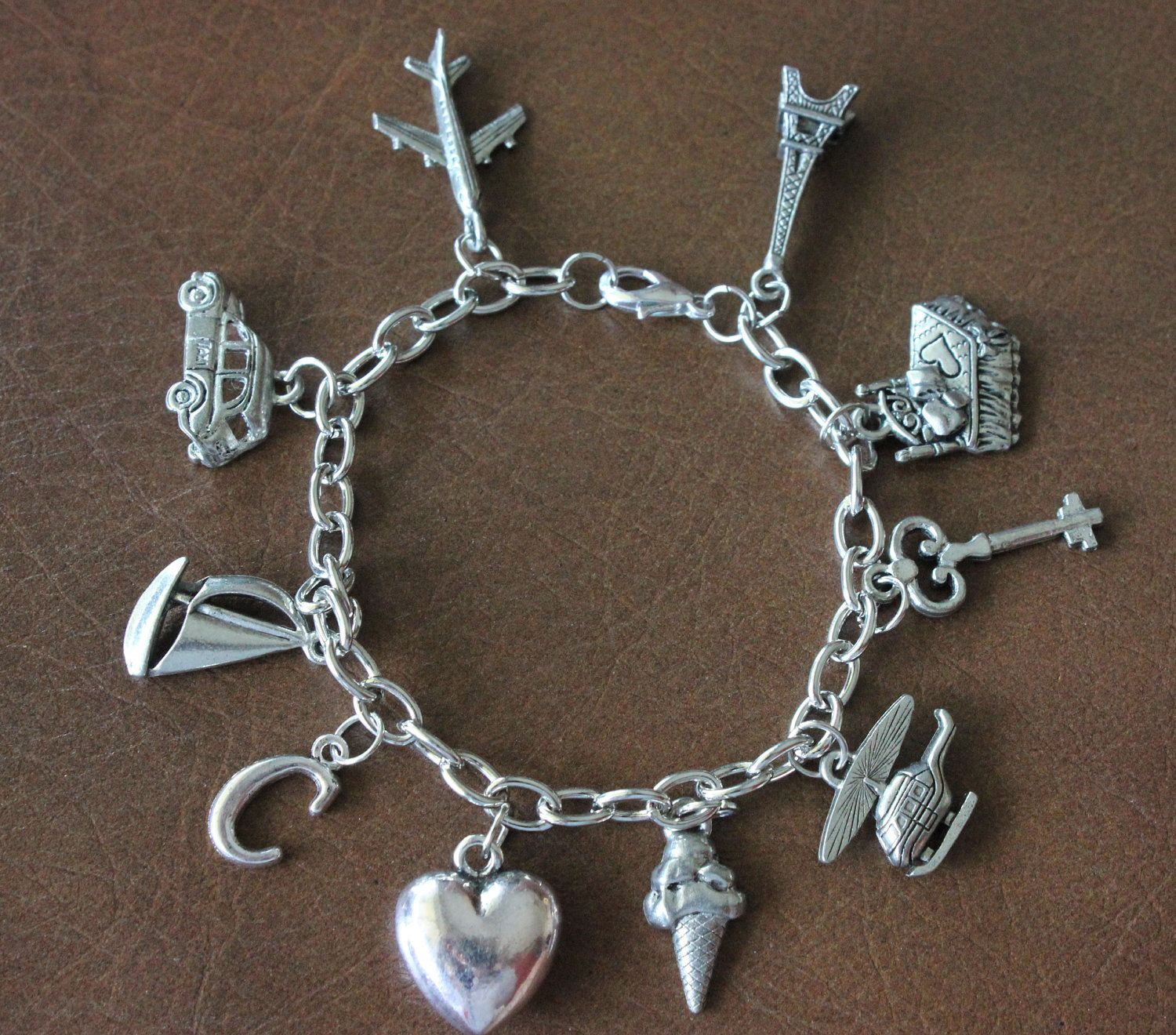 ana s charm bracelet inspired by fifty shades of grey laters  ana s charm bracelet inspired by fifty shades of grey laters baby 49 00