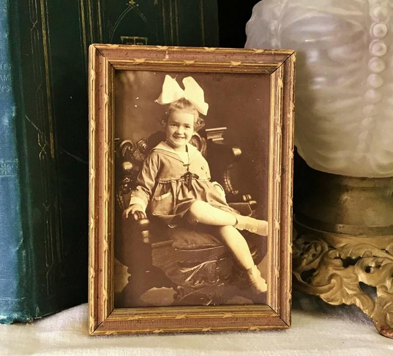 $34.95 Where can you buy an AnTIQUE WooD Picture FraME? Here and she's a real charmer. Shes sittin' in a heavy Victorian chair with her legs crossed. #sepiaPHOTOGRAPH #VICTORIANphoto #NURSERYprints #vintageANTIQUEprints #childrenPHOTOS #CarvedWoodFrame #Small Frame #SepiaPhoto #WoodFrame #PictureFrame #SepiaGirlPhoto #GirlPhotograph #OldPhotograph #AntiqueFrame #VictorianGirlHairBow #ChildSepiaPhotograph #GirlPhoto
