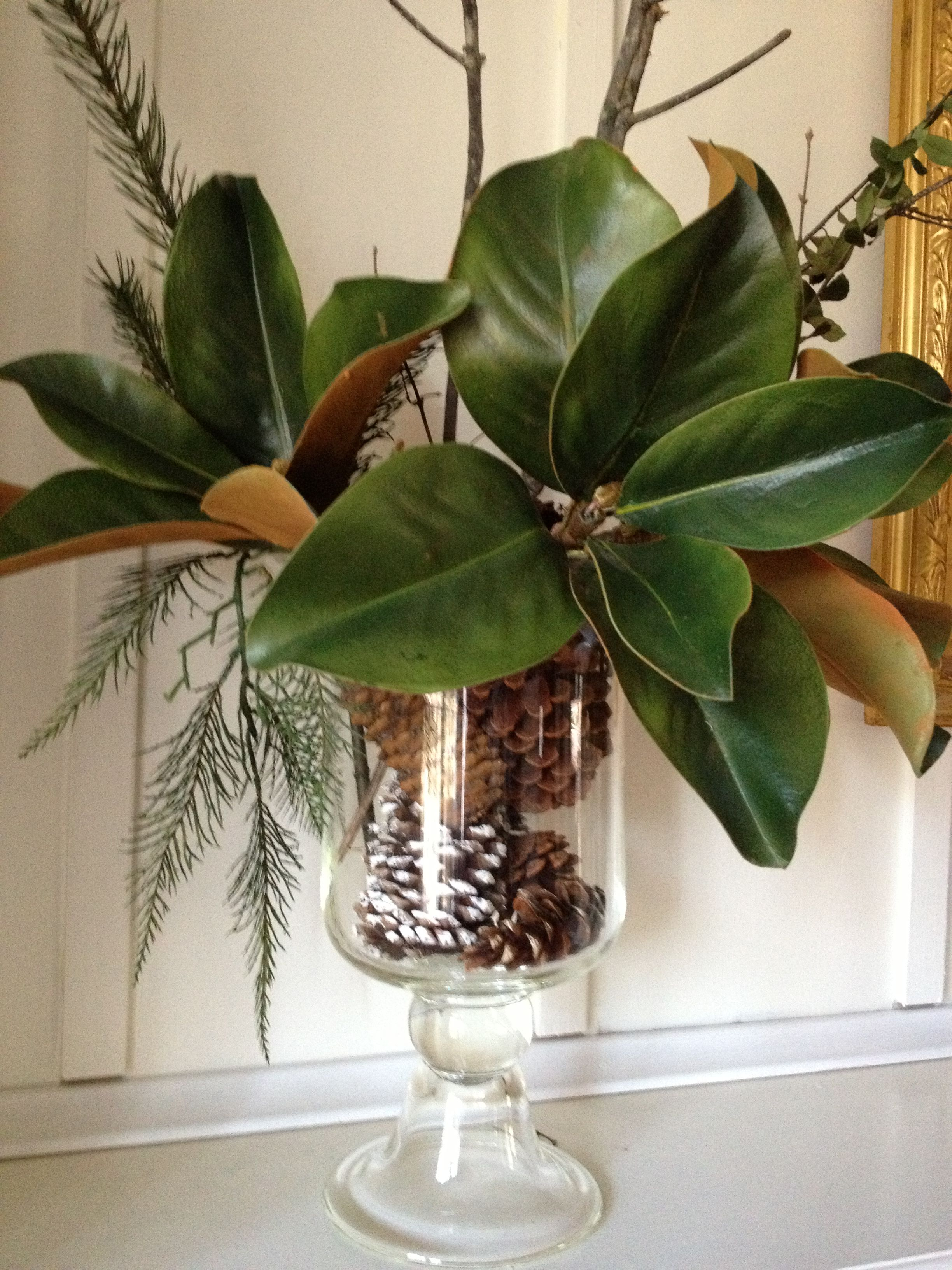 Easy holiday arrangement love the magnolia leaves