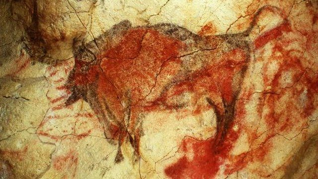 (Red dots, hand stencils and animal figures represent the oldest examples yet found of cave art in Europe, 40,000 years old)