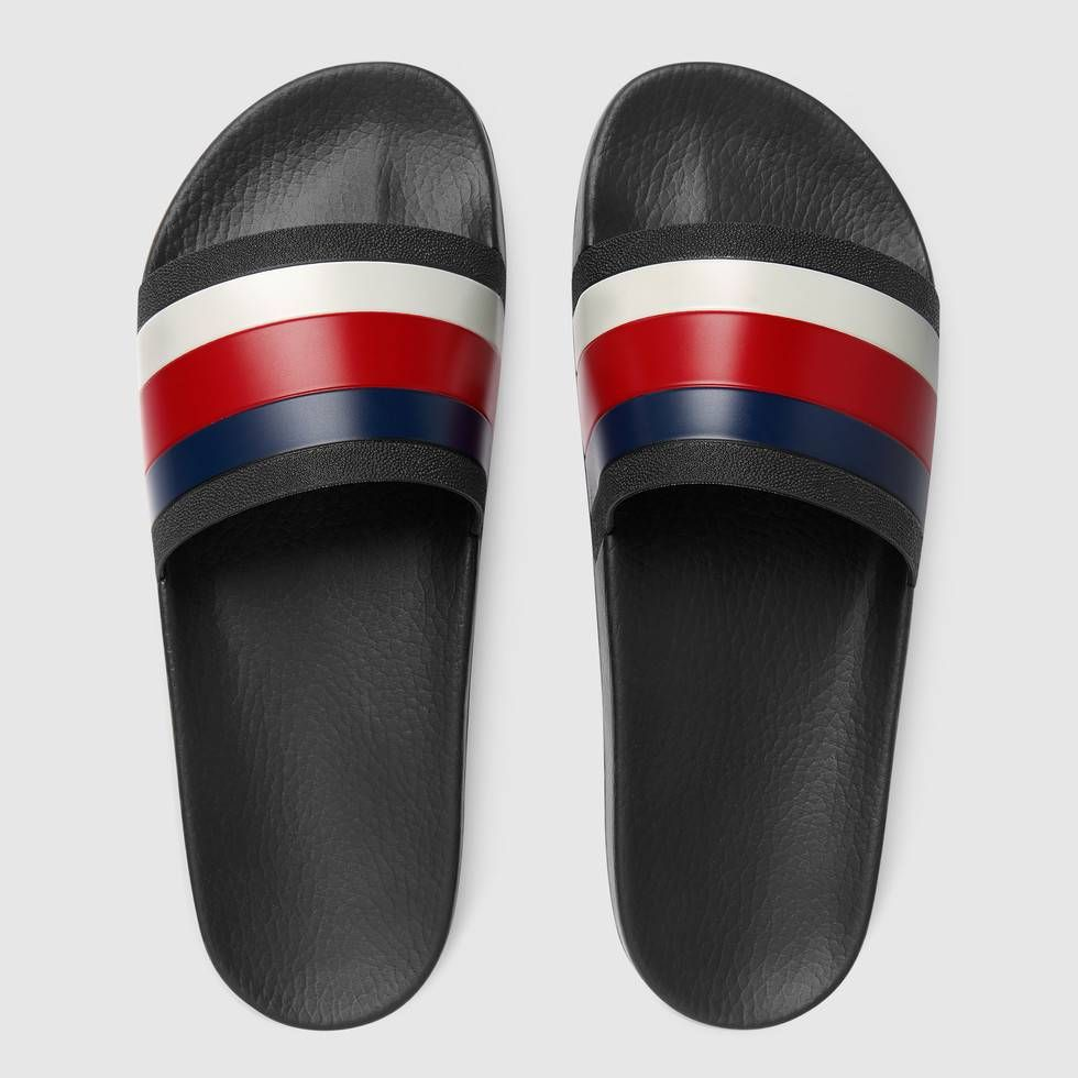 ac0147a7a4b Shop the Rubber slide sandal by Gucci. The slide sandal features a Sylvie  Web detail across the strap. The blue