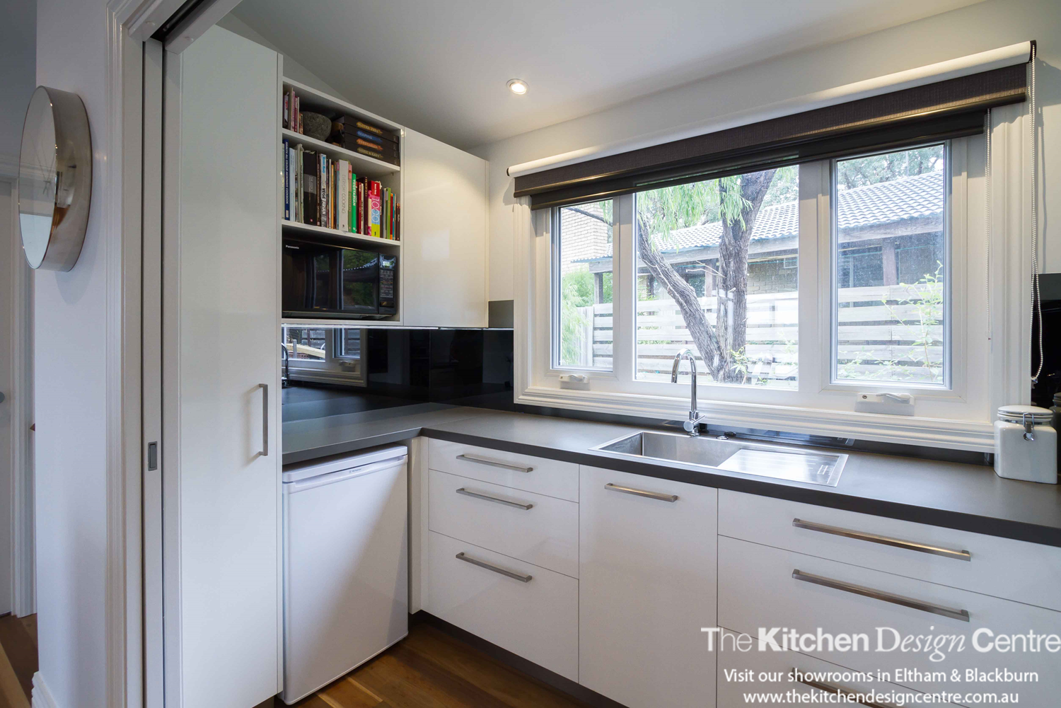 A modern sleek family kitchen designed with lots of storage and