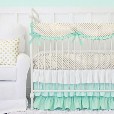 Our mint and gold dot ruffle baby bedding has a metallic flare, with a mint ruffle crib skirt and gold dot accessories.