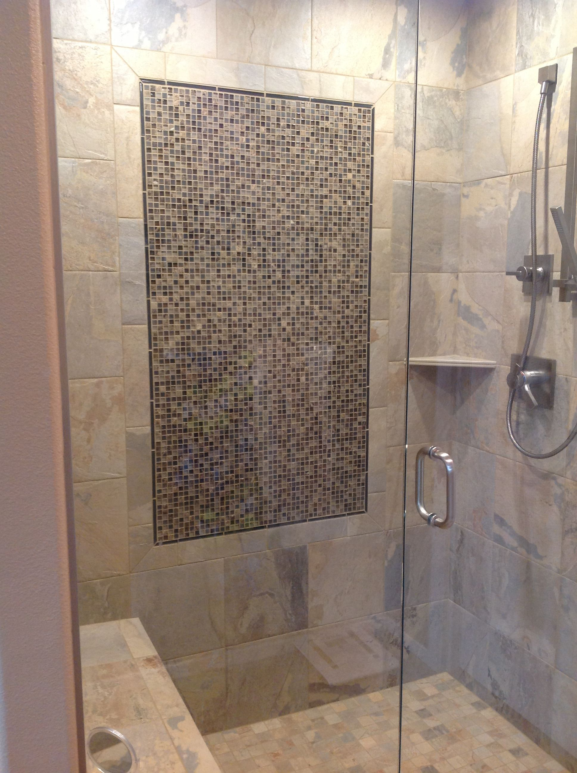 Gorgeous tile shower with a detachable shower head and bench. | http ...