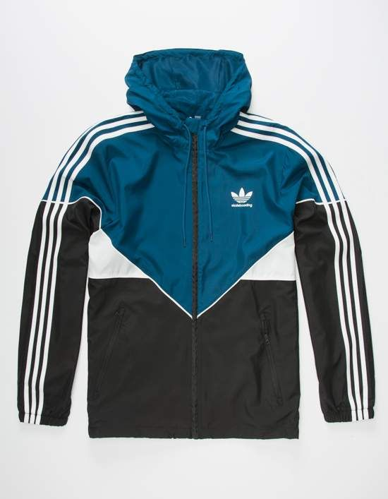 c635d9996f00 Adidas Premier windbreaker jacket. Colorblocked design. 3-Stripe appliques  at the cuffed long sleeves. Trefoil logo at the left chest. Zip front.