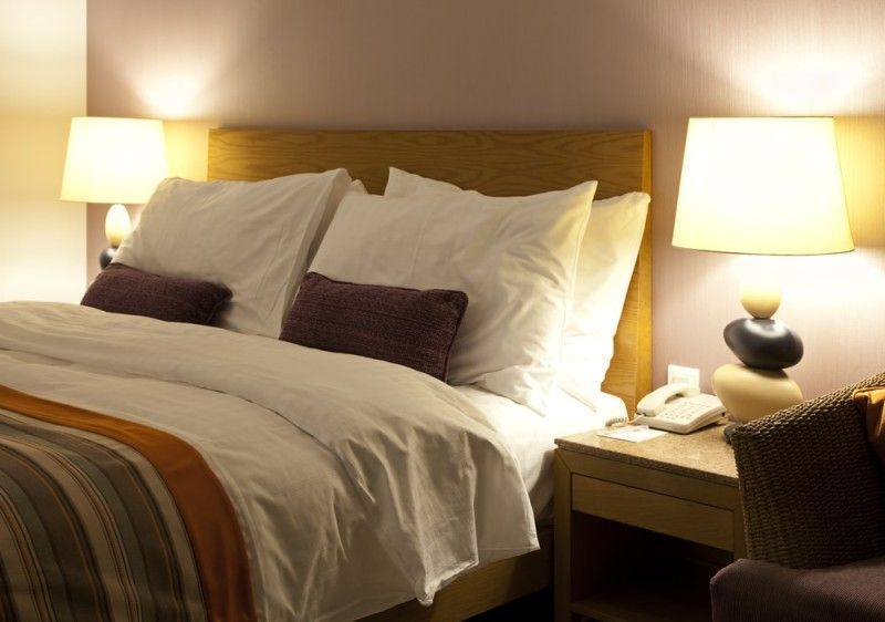 Well decorated simplistic bedroom with soft seductive ...