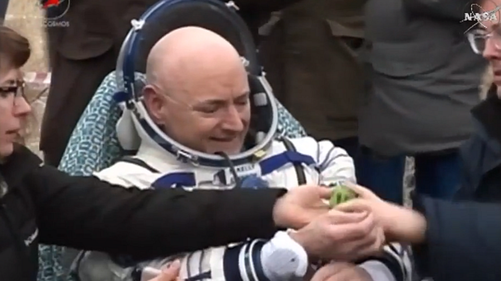 US astronaut Scott Kelly and Russian cosmonaut Mikhail Kornienko have touched down on Earth after almost a year in space.