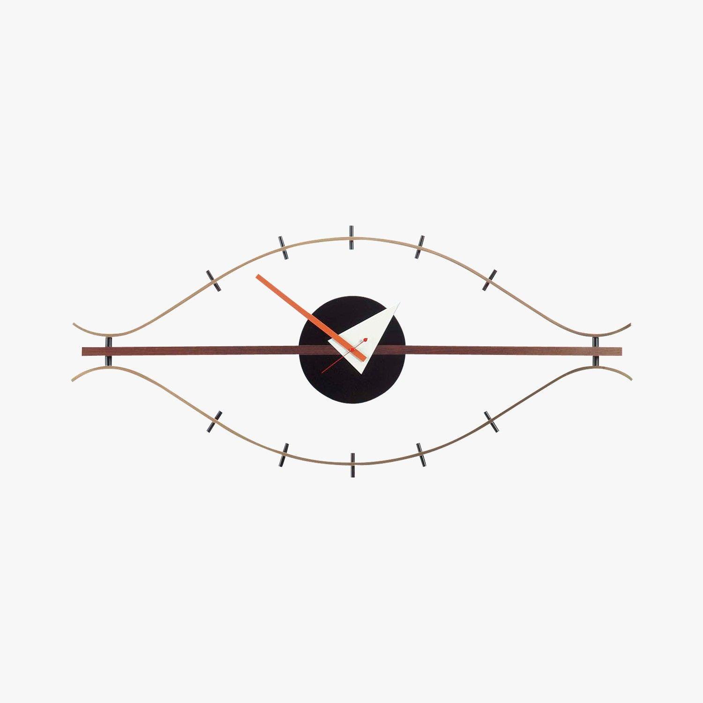 horloge bois et laiton forme œil, george nelson, 1948-1960 - vitra