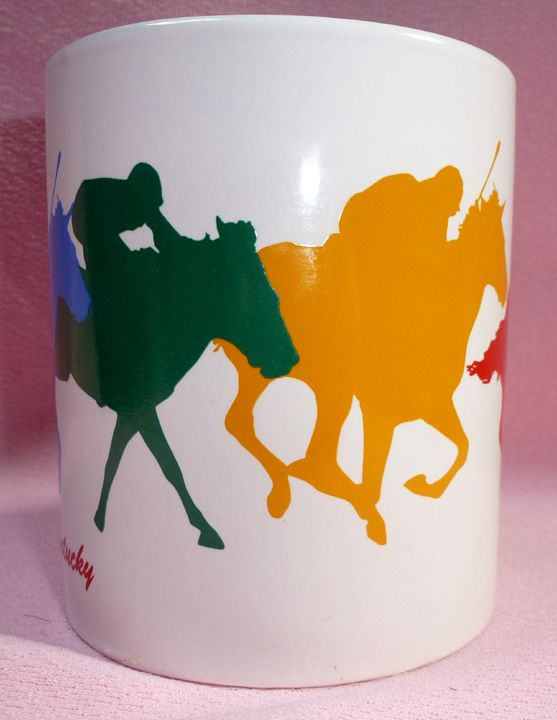 "Louisville Kentucky Derby Museum Souvenir Horse Racing Jockey Coffee Mug Cup  One coffee mug featuring a Blue, Green, Yellow, and Red Horse/Jockey Silouette running around the mug   Measures 3 3/4"" tall, 3 1/8"" wide without handle and 4 1/2"" wide with handle.  Excellent Used Condition:  No ..."