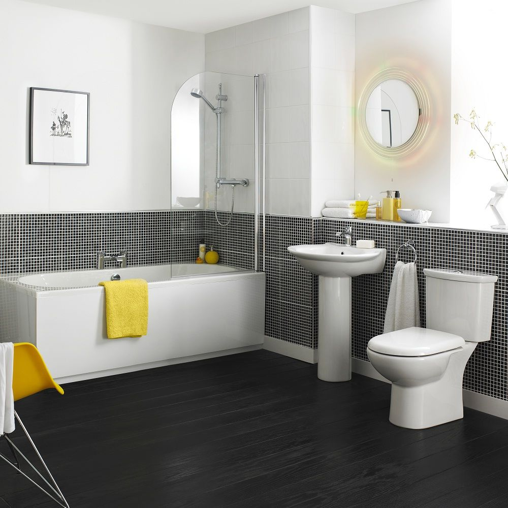 We Love How The Bright Yellow Towels And Accessories Stand Out In This Monochrome Bathroom Bathroom Suite Bathroom Suites Yellow Bathrooms