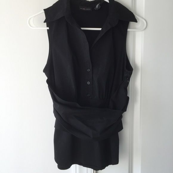 Express Wrap Oxford Faux wrap front Oxford with tie at back. Fitted and extremely flattering on. Looks great over patterned button ups or paired with a cardigan or blazer. Wore a few times for work. Side zip for easy on/off. Size small. Express Tops Blouses