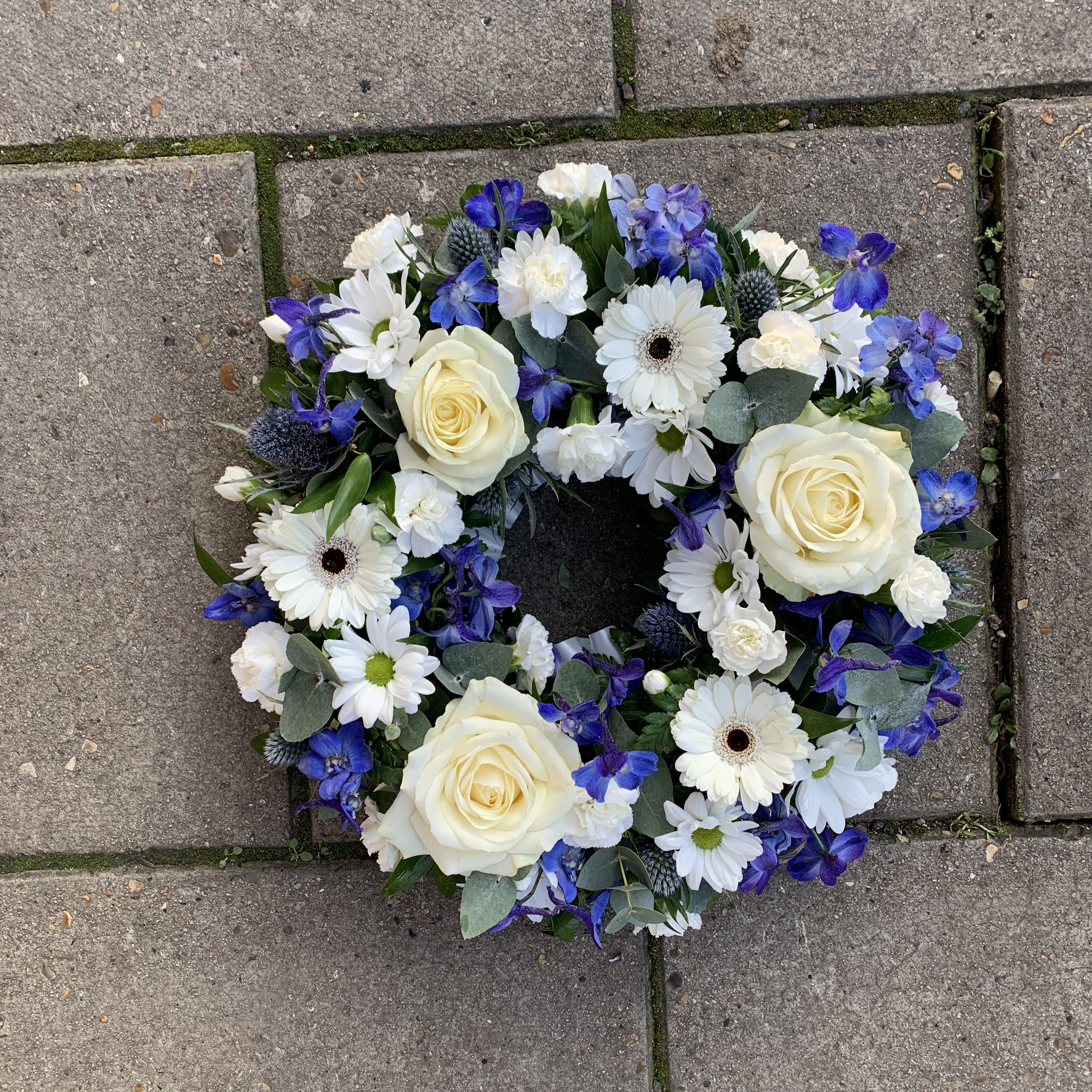 Blue and white wreath funeral flowers tribute in 2020