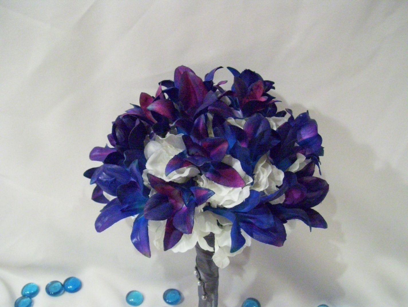 Stevieus bridesmaids bouquets with blue violet orchids flowers