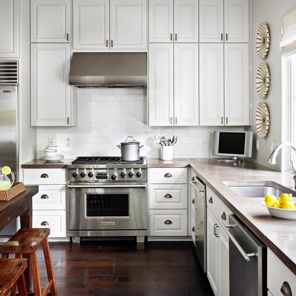 Concrete countertops and white painted cabinets contrast ...