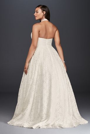 1914253e022 This plunging allover lace wedding dress is the perfect choice for a bride  who wants a