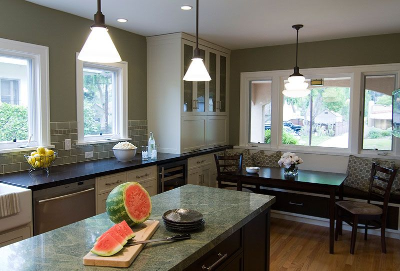 The reconfigured kitchen was able to accommodate not only an island but also a breakfast nook. The Center Residence. By Harvest Architecture.