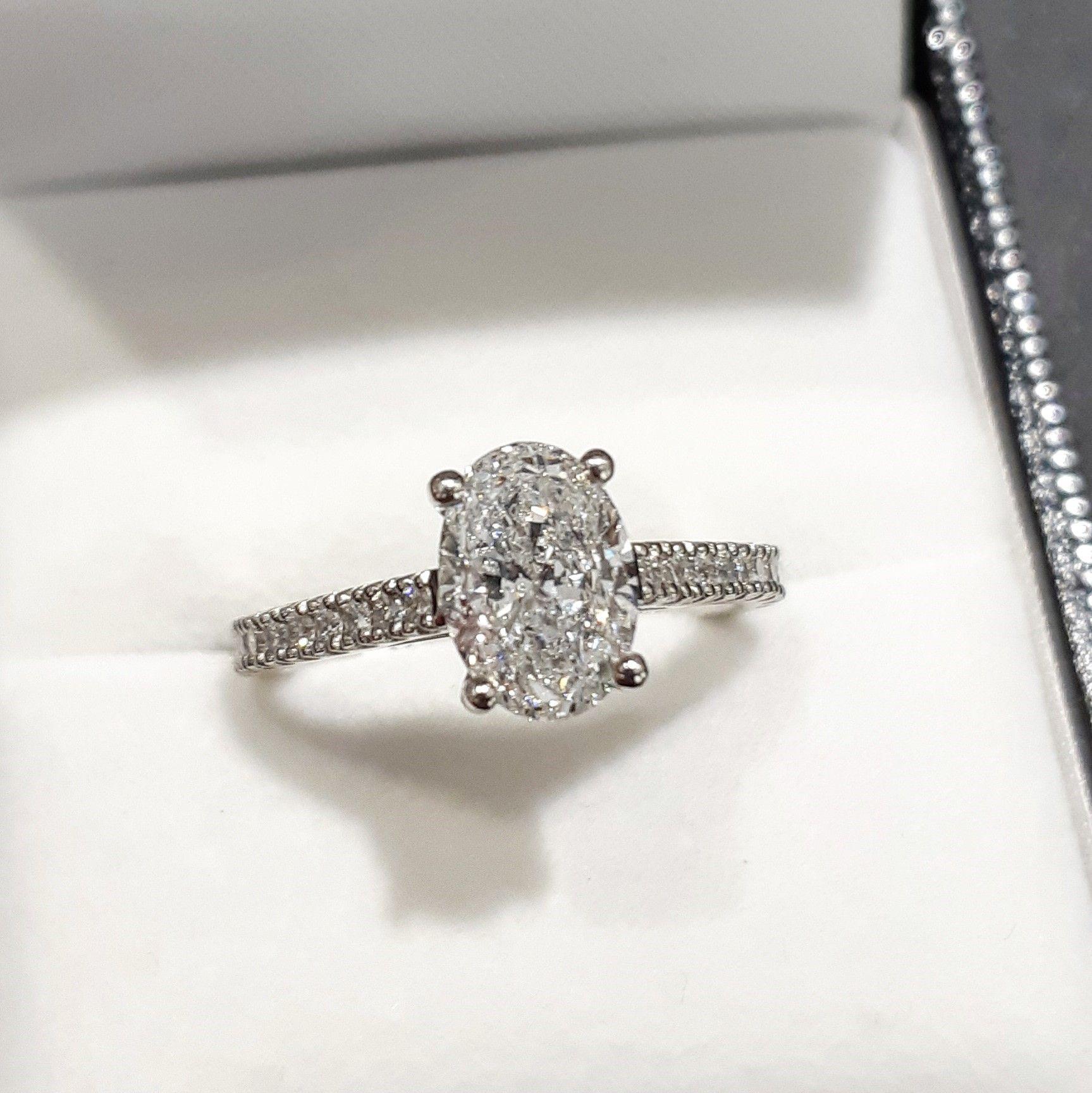 df723ab9f5c7b 1.74ct oval cut diamond engagment ring with claw set diamond ...