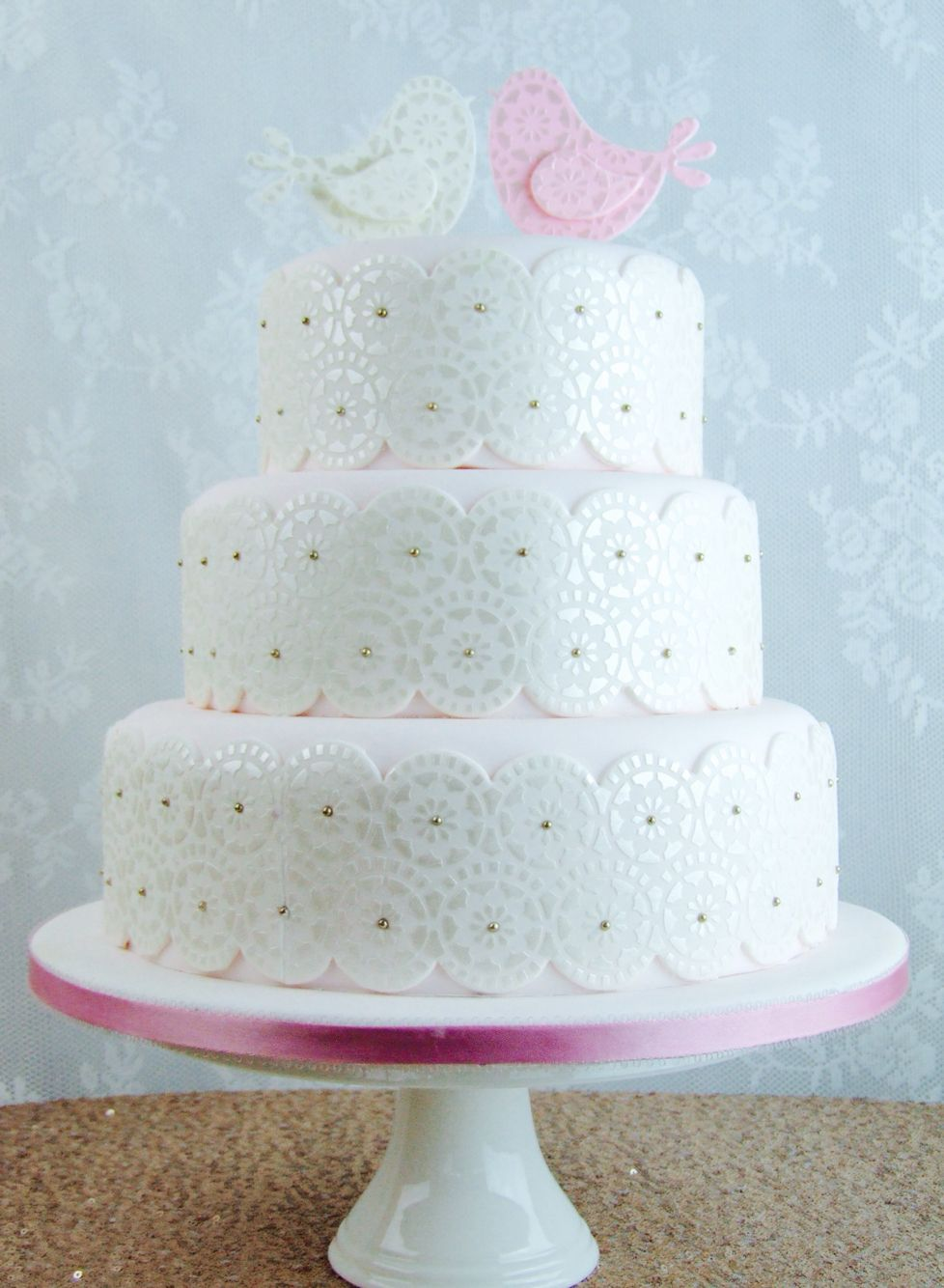 Wedding cake using quirky bird cutters as cake toppers http://www ...