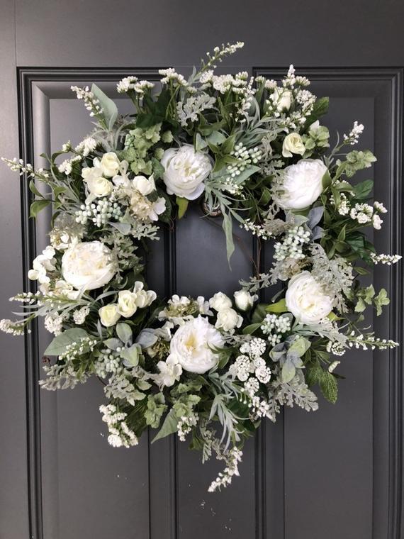 Photo of Elegant white roses grapevine wreath