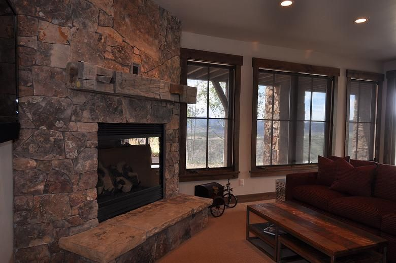 Hand-Hewn Fireplace Mantel - Park City, Utah - Hand-Hewn Fireplace Mantel - Barnwood Fireplace Mantels IDI Design