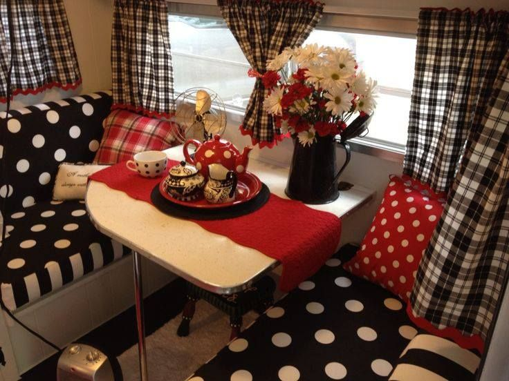 This is a wonderful interior scheme for a caravan - black and white in gingham, spots and stripes is so cheery and chic and the use of  red as a highlight brings it into the realms of perfection!