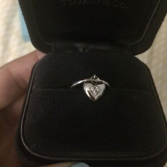 Tiffany white gold/diamond ring ❣ Size 5 1/2. It's white gold with three little diamonds.  They don't sell this heart ring anymore, it's really rare to find now!  I just had it cleaned/polished two years ago & never took it out of the box.  It was purchased in 2005 or 6?  It's super hard to take a photo of the inside where it says tiffany & co. 750, it's lightly engraved in there. Tiffany & Co. Jewelry Rings