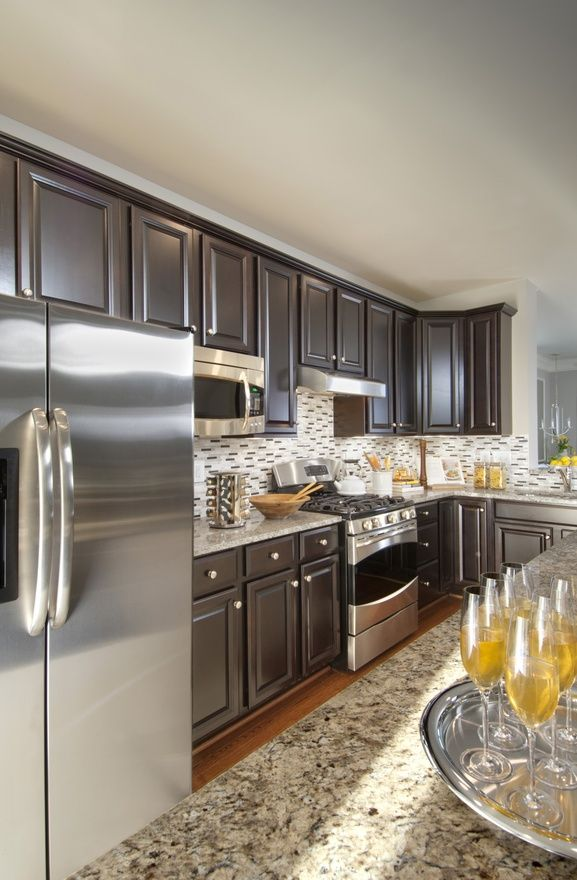 Ryan homes cabinets granite stainless steel and my new for Chocolate kitchen cabinets with stainless steel appliances