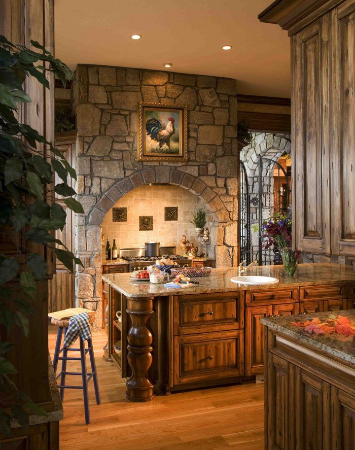 Beautiful stone-work and cabinetry in this kitchen #kitchens