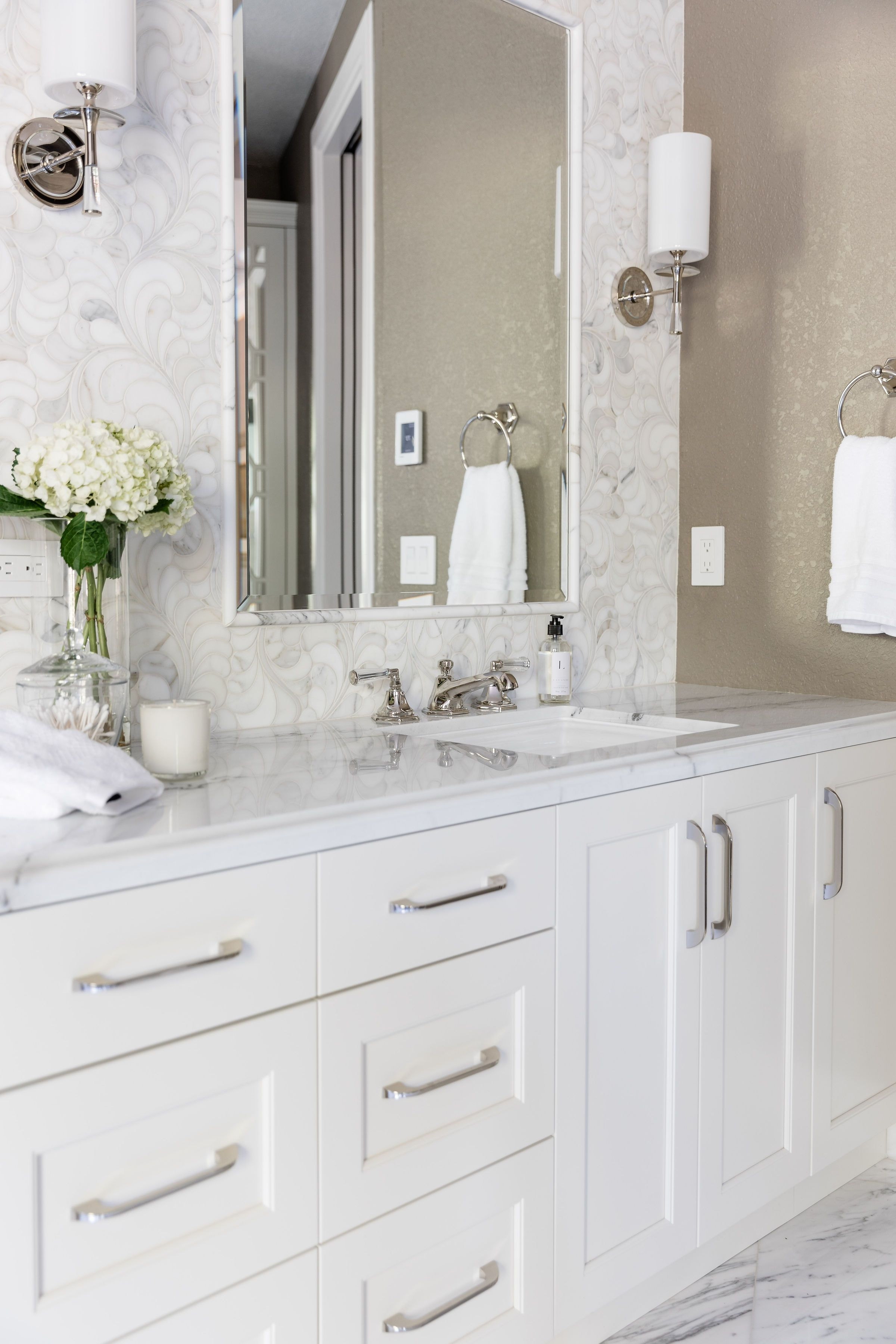 Marble Wall Marble Counters And Painted White Cabinets