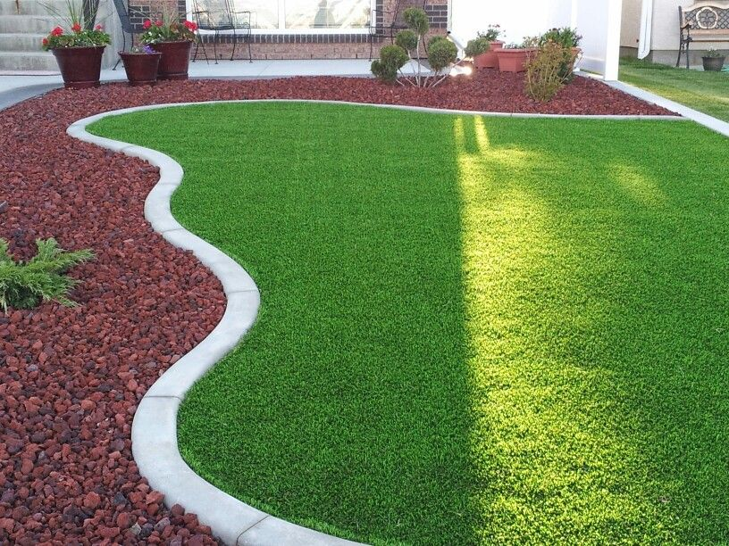 Finished front yard synthetic grass lava rock yard for Garden design ideas artificial grass