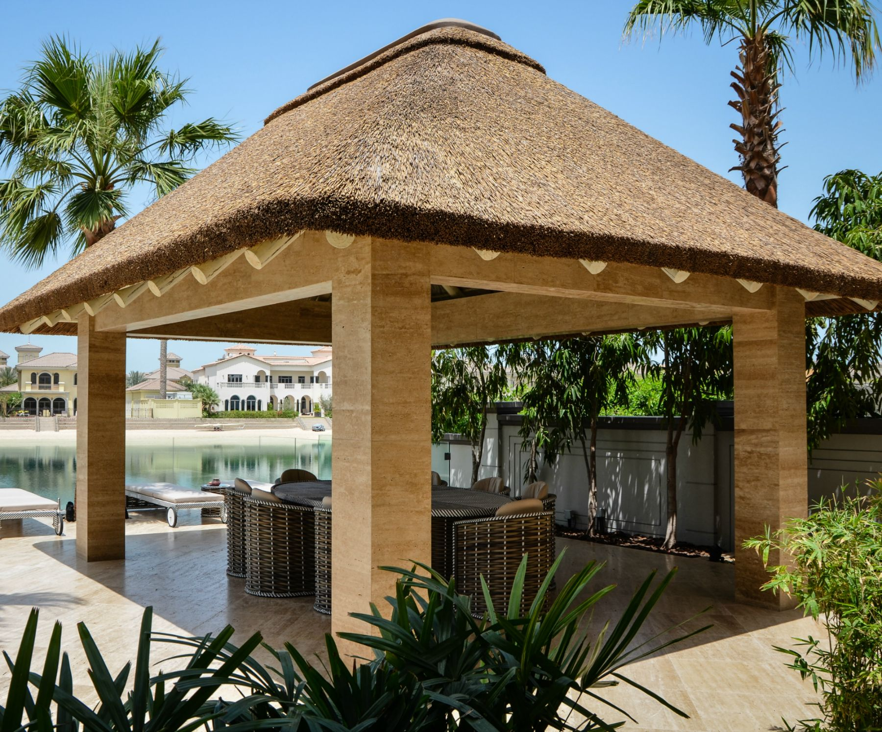 Modern thatched gazebo with concrete pillars outdoor for Outside designs of houses