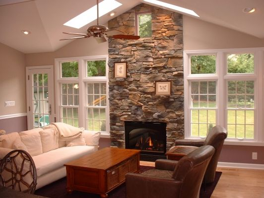 Like the windows, fireplace and vaulted ceiling.