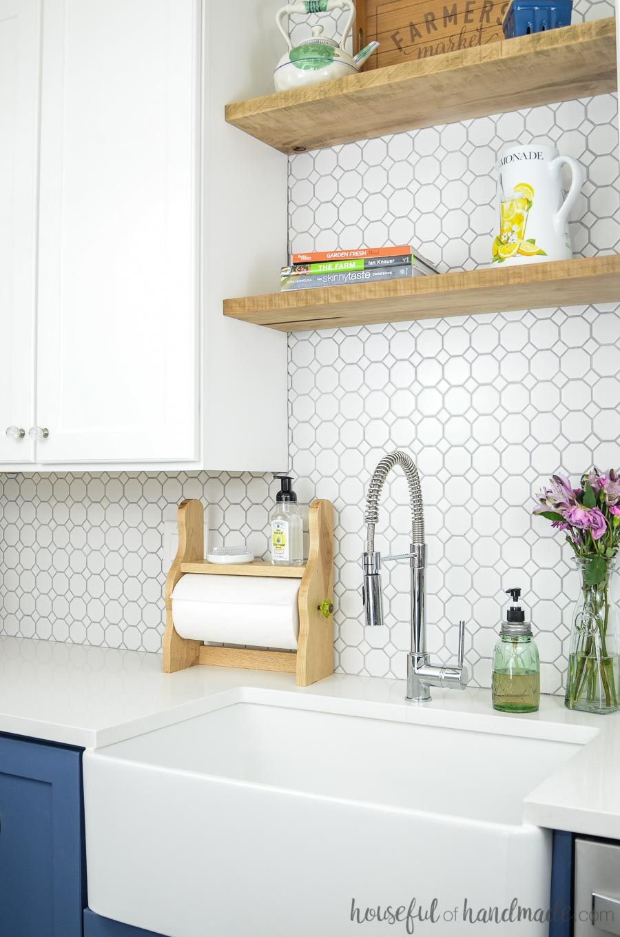 White kitchen with open shelves and white octagon tile backsplash beautiful farmhouse paper towel holder with shelf behind apron front sink