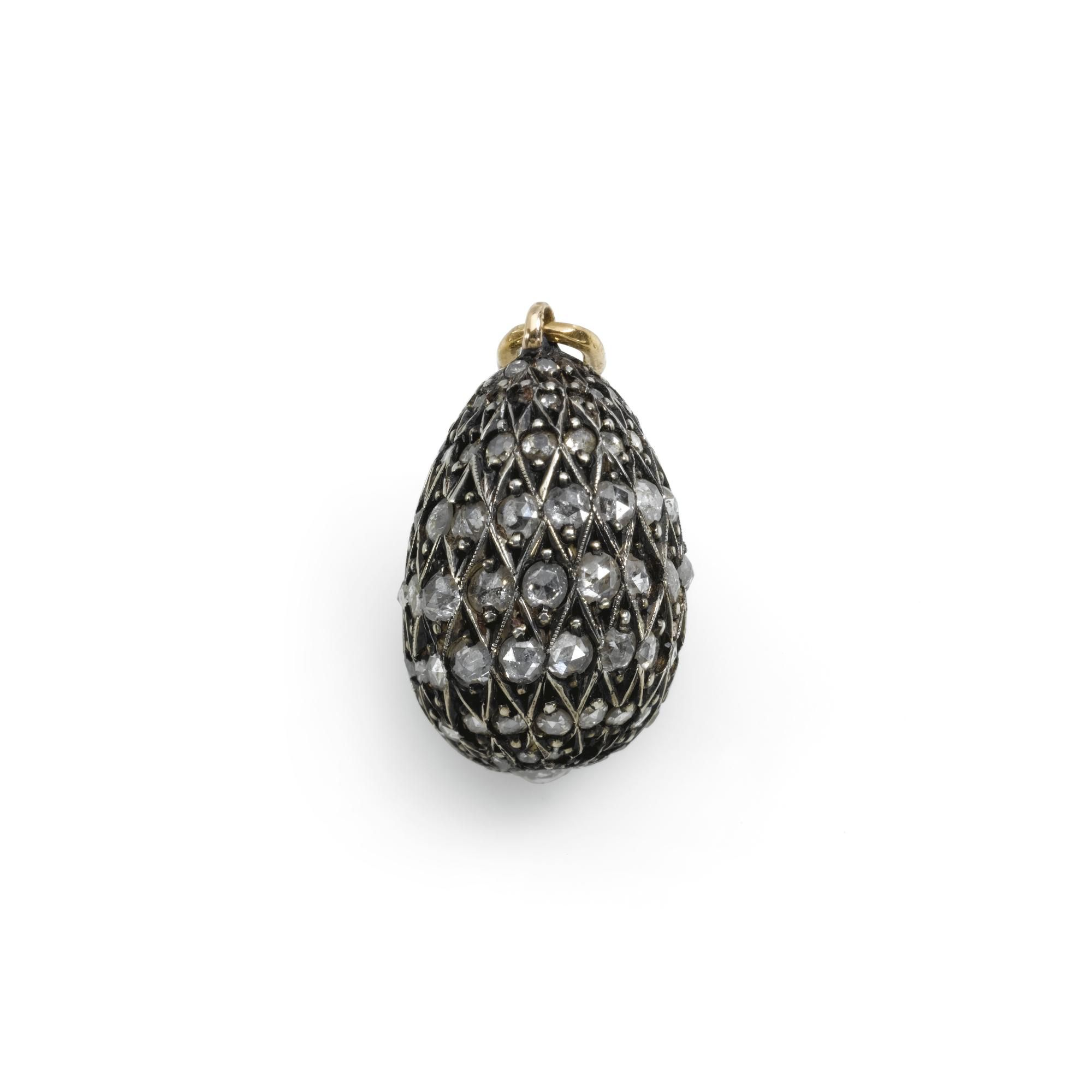 A fabergÉ silver gold and diamond egg pendant workmaster august