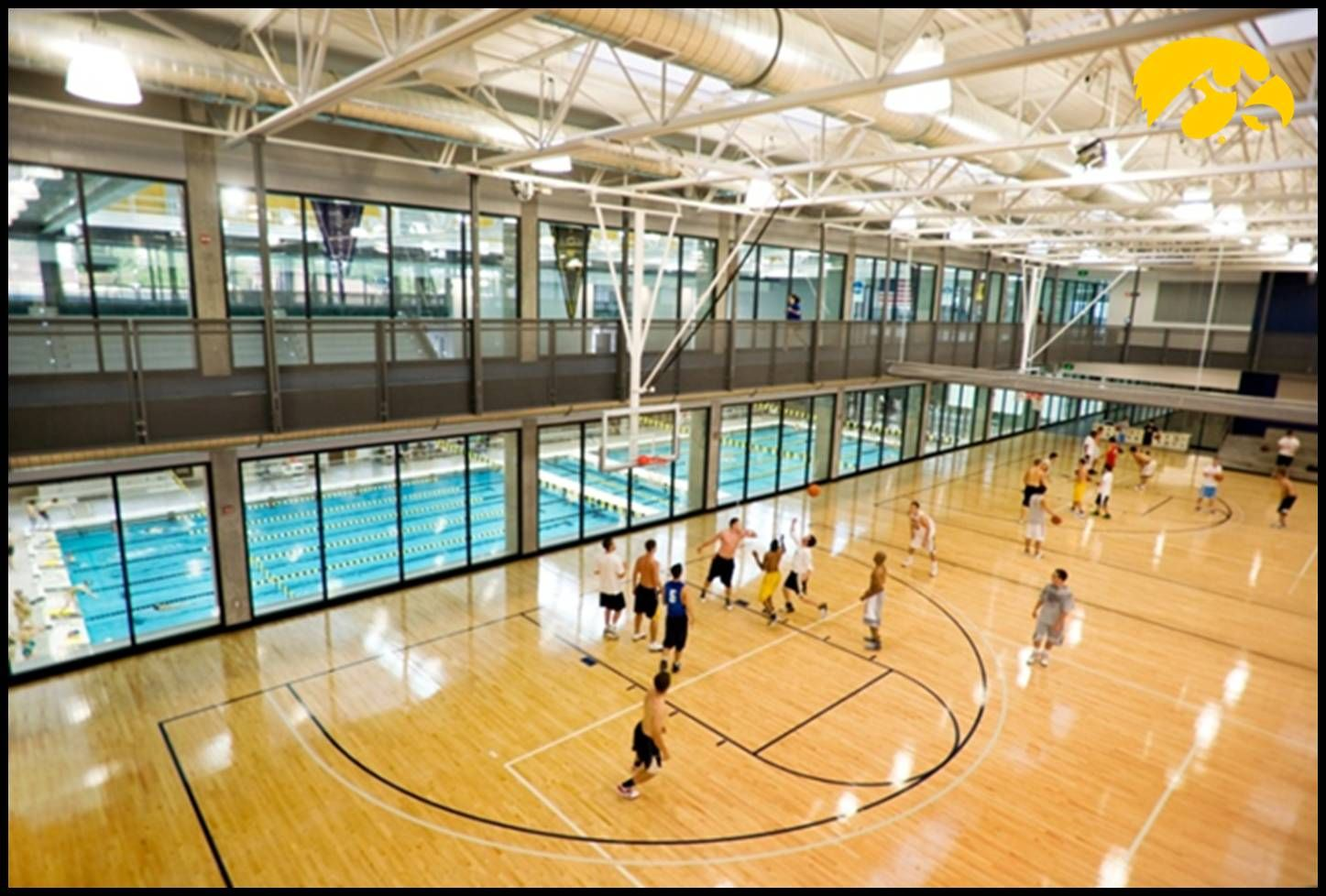 Iowa S Basketball Courts Provide A Scenic View Over The Aquatics Area Recreation Centers Sports Training Facility Sports Complex