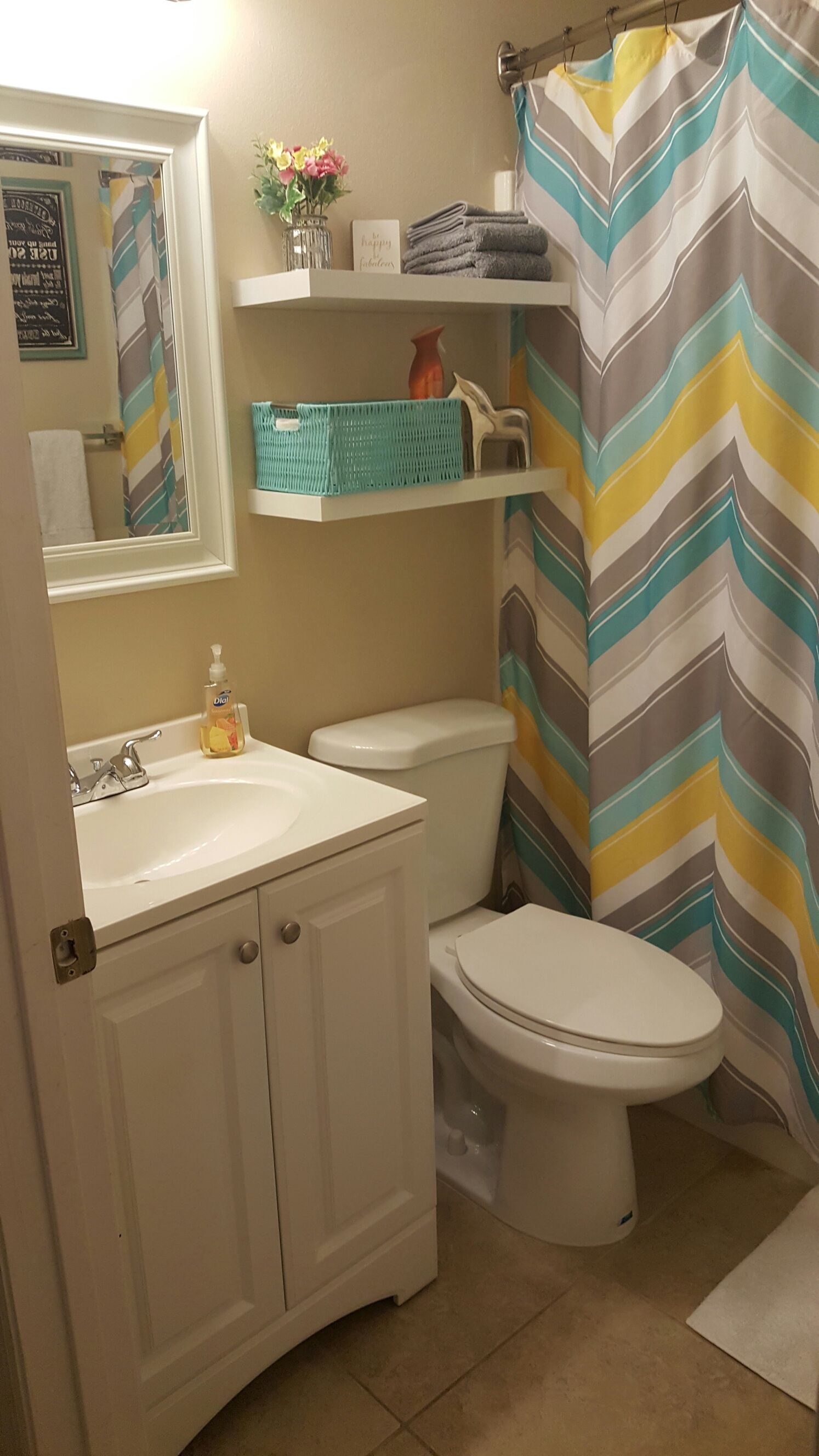 small bathroom update. less than $100. lowe's and hobby lobby